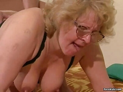Blonde granny loves playing with her hairy pussy