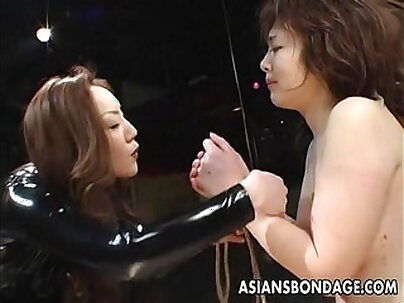 Asian hottie is dominated by her man and gives head