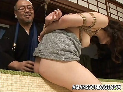 Tied up Asian babe gets spanked and dildo fucked