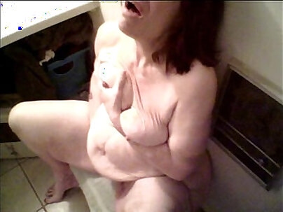 babe with short hair is masturbating wearing clothes